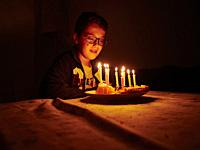Boy at home looking his birthday cake, Valencia, Valencian Community, Spain.