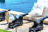 Maltese soldier firing from cannon.