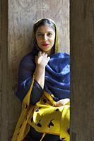 Iran, Isfahan, World Heritage Site, Naqhsh-e Jahan Square (Imam square), Ali Qapu palace, Young woman.