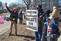 Detroit, Michigan - People rally in support of Amazon workers who are trying to form a union at an Amazon warehouse in Bessemer, Alabama. It would be ...