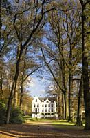 Castle Staverden near Ermelo in the Dutch region Veluwe seen from the surrounding autumn mooded park.