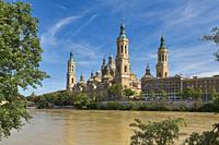 Zaragoza, Zaragoza Province, Aragon, Spain. The Baroque style Basilica de Nuestra Señora del Pilar, or Our Lady of the Pillar, seen across the Ebro Ri...