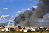 Malaga, Malaga Province, Andalusia, southern Spain. Pall of black smoke from fire in paper recycling warehouse on March 13, 2013.