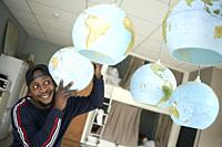 optimistic African man listening to excitement of world globes