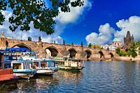 Charles Bridge, Tourboats on Moldau river, Prague, Czech Republic, Europe