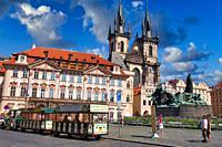 Jan Hus Memorial and Tyn church in Staromestske Namesti (Old Town Square), Prague, Czech Republic, Europe.