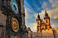 Astronomical clock on the Old Town City Hall and Tyn church, Staromestske Namesti (Old Town Square), Prague, Czech Republic, Europe.