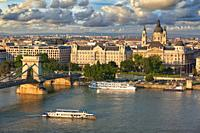 Szechenyi Chain Bridge over Danube river, Gresham Palace and St. Stephan, Budapest, Hungary, Europe