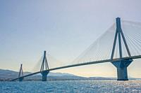Greece. High pylons of the Rion Antirion cable bridge across the Gulf of Corinth in sunny weather. Lower view.