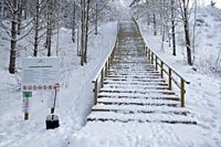 Snow covered wooden stairs outdoors in Huhtiniemi, Lappeenranta Finland.
