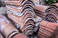 Packs of used mediterranean roof tiles or monk and nun. Selective focus.