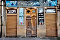 Facade of an old hardware store in a Main square of Viana do Bolo, Orense, Spain