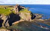 Aerial view of Tantallon Castle on sea cliffs coast in East Lothian Scotland UK.
