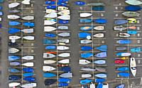 Sailing boats stored in rows on dry land during coronavirus lockdown at North Berwick harbour in East Lothian. Scotland, UK.