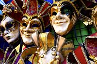 Grotesque costumes at Carnival of Venice, Italy, European traditions