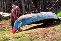 Boat maintenance, Kampong Phulk when dry season, Tonle Sap lake, Siem Reap, Cambodia