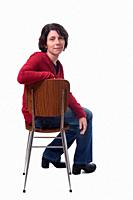 portrait of a woman sitting on a chair on white background,.