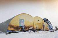 Polar bear painted on frotn of polar bear jail, Churchill, Manitaba, Canada.