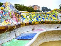 Curved mosaic tiled benches in the Plaça de la Natura terrace of Parc Guell, Barcelona, Catalonia, Spain.