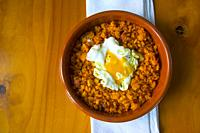 Migas with fried egg. Spain.
