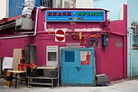 Singapore, Republic of Singapore, Asia - Rear exit of a small Indian restaurant in a narrow side street in Little India city district.
