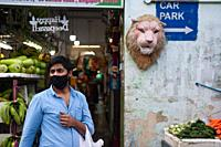 Singapore, Republic of Singapore, Asia - A man wearing a protective corona face mask buys groceries in the city district of Little India.