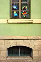 Window decorated with children´s drawings and window with bars, Verd school, Girona, Catalonia, Spain
