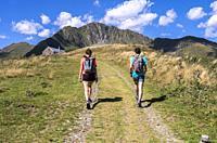 Hikers, Pyrenees Superbagnères, Bagnères-de-Luchon, Haute-Garonne department, Occitanie, France.