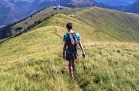 Hiker, Superbagnères, Bagnères-de-Luchon, Pyrenees, Haute-Garonne department, Occitanie, France.