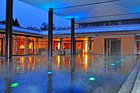 Illuminated outdoor pool of the luxury resort park weggis hotel near Lucerne.