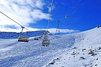 Swiss alps: Wintersport transport at Parsenn above Davos-City. Due to global clima change there is more and more artificial snow.