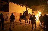 ESTERCUEL TERUEL PROVINCE ARAGON SPAIN ON JANUARY 18, 2020: La Encamisada feast when men rides his horses through the fire in the traditional celebrat...