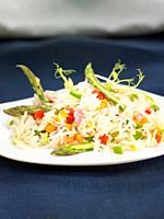 basmati rice scented with vegetables, wild asparagus, green and red peppers, carrots and onion.