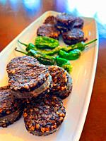 Fried morcilla with green peppers. Spain.