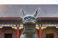 Bronze Quilin sculpture in fron of palace buildings at the Summer Palace in Beijing, China in March 2018.