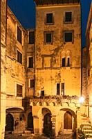 Terracina, Italy Gothic Domus Of Piazza Cancelli In Evening Or Night Illuminations.