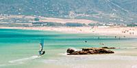Tarifa, Spain People Surfing and resting at beach. Tarifa is most popular places in Spain for surfing And vacation.