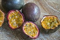 Isolated passion fruit cut in half on wooden background.