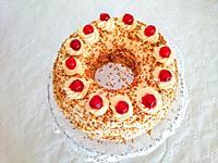 A whole Frankfurter Kranz or Frankfurt Crown Cake on a plate.