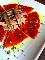Salad made of Piquillo peppers, tuna loin, anchovy fillets, parsley and olive oil. Spain.