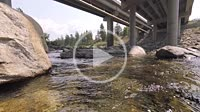 Water flowing under a bridge on the Spokane River, Spokane Valley, Washington, USA.