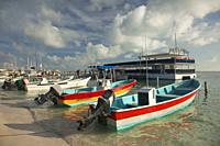 Traditional fishing boats near the pier at the town center, Isla Mujeres, Cancun, Quintana Roo, Mexico, Central America.