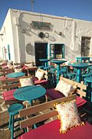Tables and chairs of a fancy bar-restaurant at the town center, Naoussa, Paros Island, Cyclades Islands, Greek Islands, Greece, Europe.