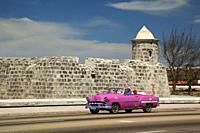Old American car used as taxi in front of the Castillo De La Punta- Castle, Havana , La Habana, Cuba, West Indies, Central America.
