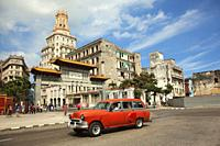 Old American car used as taxi in front of the Gate of Chinatown- Barrio Chino at Center Havana , La Habana, Cuba, West Indies, Central America.