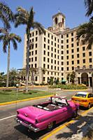 Old American car used as taxi in front of the Hotel Nacional at Vedado district, Havana , La Habana, Cuba, West Indies, Central America.