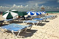 Sunbeds and umbrellas at the North beach near the town center, Isla Mujeres, Cancun, Quintana Roo, Mexico, Central America.