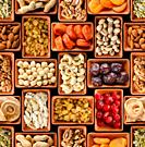Seamless flat lay food background of dehydrated fruits, seeds and nuts on black. Non-perishable antioxidant gluten free foods concept.