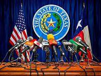 Press conference of governor of the state of Texas concept. Microphones TV and radio channels with symbol and flag of Texas state. 3d illustration.