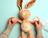 soft plush rabbit with a bandaged paw with a white medical bandage, trauma.